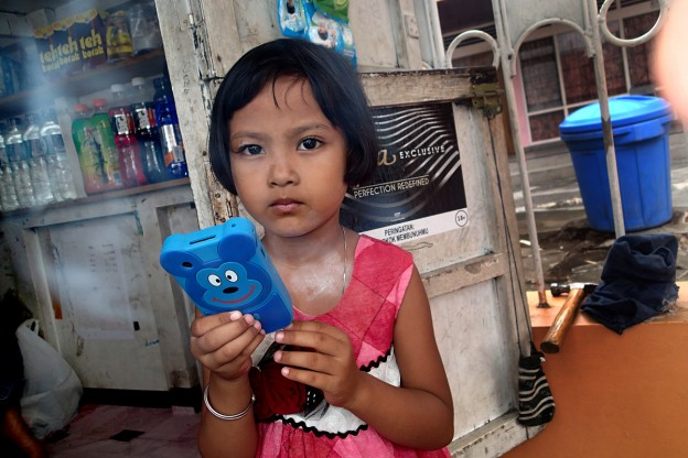 Four-year old Juna with her smartphone